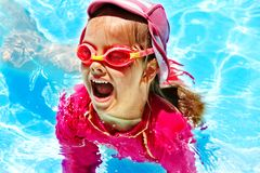 Child in swimming pool. Summer outdoor stock photography