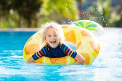 Child in swimming pool. Summer vacation with kids. stock photos