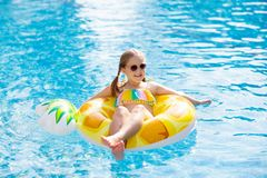 Child in swimming pool. Summer vacation with kids stock images