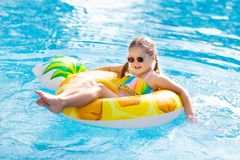 Child in swimming pool. Summer vacation with kids stock photo