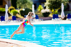 Child in swimming pool on summer vacation Stock Images