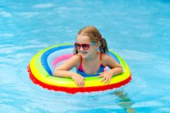 Kids play in snow winter sleigh ride for children stock - Swimming pool girl christmas vacation ...