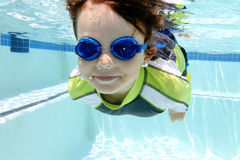 Child Swimming in Pool Underwater Royalty Free Stock Photography