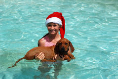 Child swimming with puppy Royalty Free Stock Photos