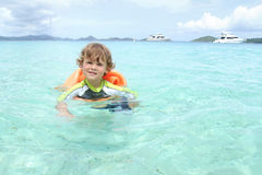 Child Swimming in Tropical Ocean Stock Photography