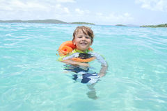 Child Swimming in Tropical Ocean Royalty Free Stock Image