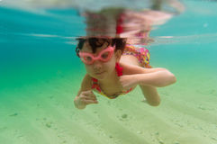 Child swimming underwater in sea Stock Photo