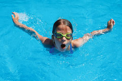 Child swims butterfly style Royalty Free Stock Photography