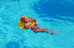 Child swims in the pool Stock Images