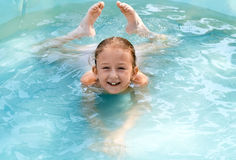 The child swims Stock Images