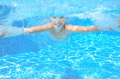 Child swims in pool underwater Stock Photography