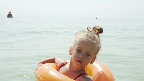 Child swims sea inflatable ring. danger of drowning Safety equipment, Child Life buoy