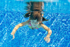 Child swims underwater in pool Royalty Free Stock Photo