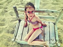 Child in a swimsuit on the beach royalty free stock image