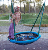 Child on a swing. In the park by the lake Bundek in Zagreb Stock Images
