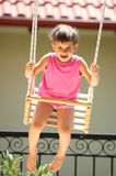 Child on swing Stock Images
