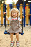 Child on swing. In summer park stock photography
