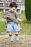 Child on a swing Stock Photos