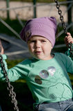 Child on a swing Stock Images