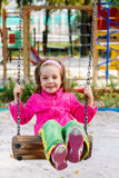 Child on a swing. Happy child on a swing royalty free stock photography