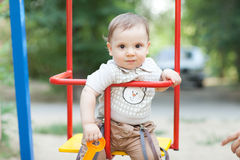 Child on the swing Stock Images