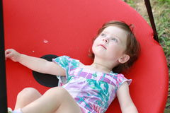 Child in the swing. Blessed child in the swing Royalty Free Stock Photo