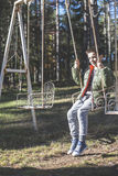 Child on a swing. In a forest Royalty Free Stock Photography