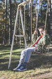 Child on a swing. In a forest Royalty Free Stock Photos