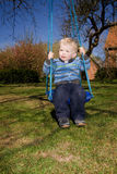 Child swing garden. Child on swing in garden. boy in playing activity Stock Images