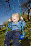 Child swing garden. Child on swing in garden. boy in playing activity Royalty Free Stock Photos