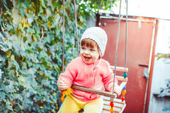 Child on the swing Stock Image
