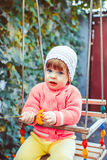 Child on the swing Royalty Free Stock Photo