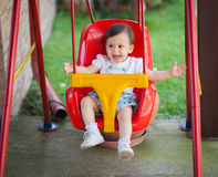 A child on a swing. A happy child on a swing stock photography