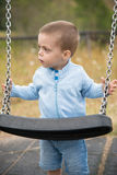 Child swing Stock Images