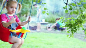 Child on swing stock video