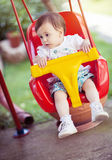 A child on a swing. Outdoor portrait royalty free stock photography
