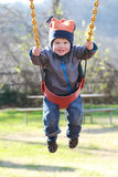 Child on Swing at a Playground Stock Photography