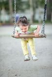Child on a swing. On the playground stock image