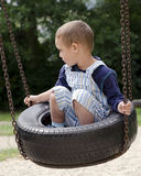 Child on swing at playground Stock Images