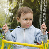 Child on swing Stock Photography