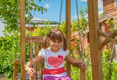 child on a swing Royalty Free Stock Photo