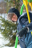 Child on swing in winter Stock Images