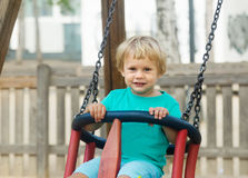 Child on swing Royalty Free Stock Photography