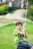 Child on swing Stock Photo