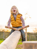 Child swinging outdoors Royalty Free Stock Photography
