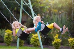 Child swinging on playground. Kids swing royalty free stock photo