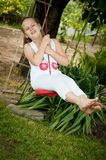 Child swinging on seesaw Stock Photography