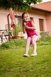 Child swinging on seesaw Royalty Free Stock Photo