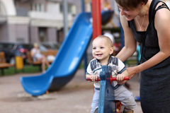 Child swinging on spring toy horse. Child is swinging on spring toy horse at playground Royalty Free Stock Photos