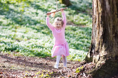 Child swinging on tree rope swing Royalty Free Stock Photos